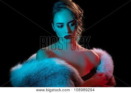 Gorgeous beauty posing in expensive fur coat