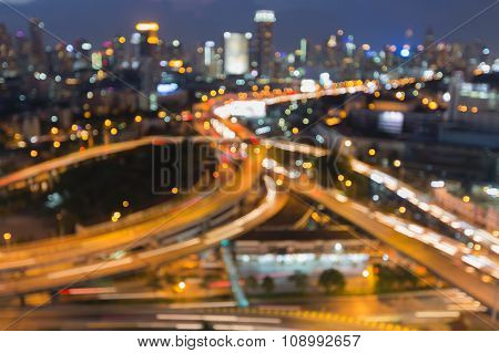Beauty of blurred bokeh lights cityscape and interchanged road night view