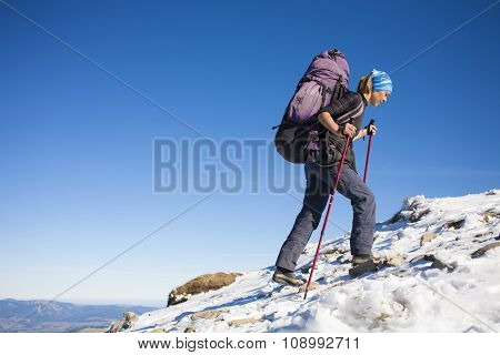 The Girl With The Backpack Is On The Slope.