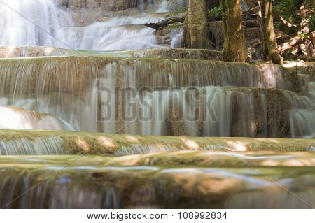 Closed up multiple layer water falls in deep forest