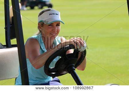 Smiling Ladies Pro Golfer Daniella Montgomery Behind Steering Wheel Of Golf Cart November 2015 In So