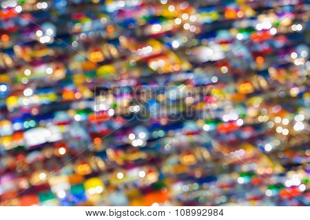 Top view of colourful free market at night, blurred bokeh lights at night