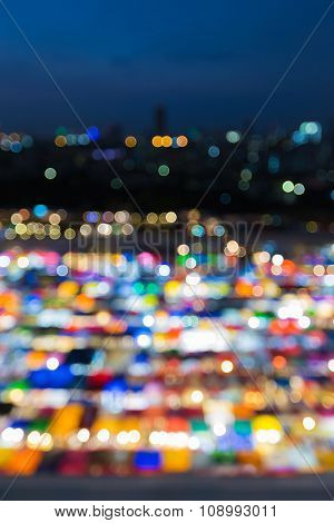 Blurred bokeh multiple colour weekend market roof top night view