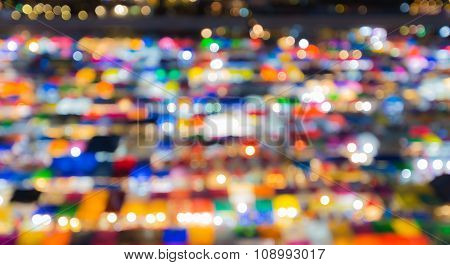Blurred bokeh aerial view multiple colour weekend market roof top