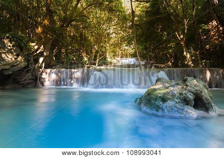 Blue stream water falls in deep forest national park