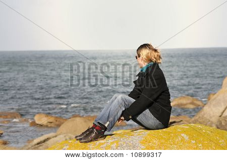 Young Woman Watching The Ocean