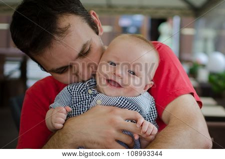 Father Hugs His Son