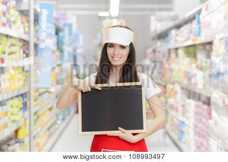 Smiling Supermarket Employee Holding a Blank Blackboard