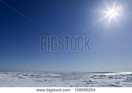Bright sunshine above the frozen sea.