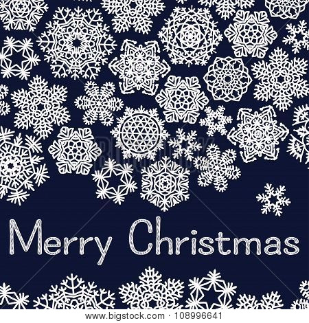 Christmas greeting card with text Merry Christmas and snowflakes. White snowflakes on dark blue  bac