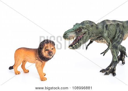 Tyrannosaurus And Lion Toys On A White Background