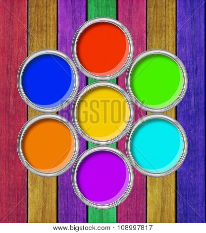 Open Tin Cans With Paint On The Painted Wooden Background