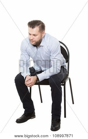 man sitting on chair. Isolated white background. makes decisions. aggressive. clenched fist