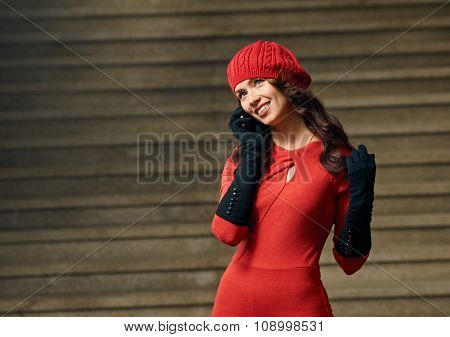 woman talking by phone on stairs