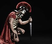 image of spartan  - Portrait of a legionary soldier standing on his knee - JPG