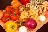 A Bounty Of Italian Foods Resting On A Cutting Board poster