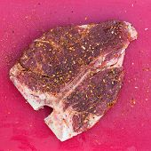 Постер, плакат: Raw T bone Steak With Seasoning