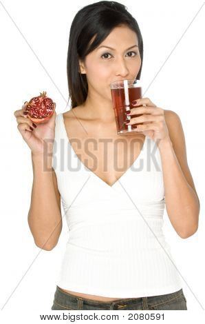 Woman With Pomegranate And Juice