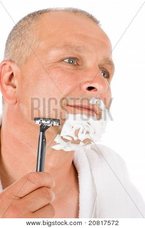 Male Cosmetics - Mature Man Shaving His Beard