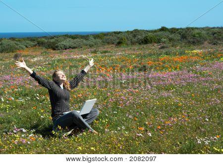 Blonde Woman In The Field Of Flowers