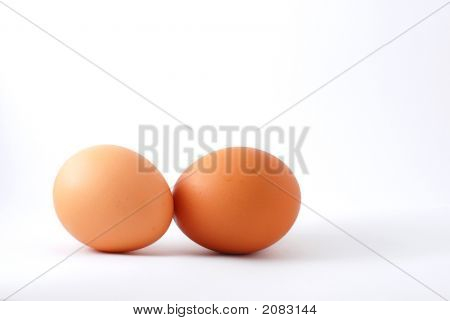 Two Chicken Eggs On White Background