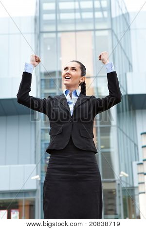 Businesswoman Standing Outdoor  And Celebrating