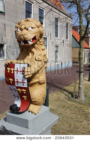 Statue of a lion with a shield