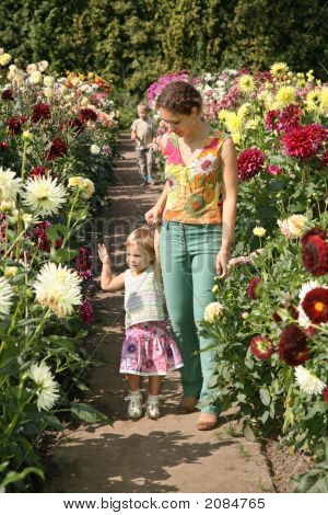 Mother And Children In Flowers