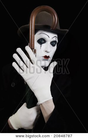Mime Holding A Walking-stick In His Hand
