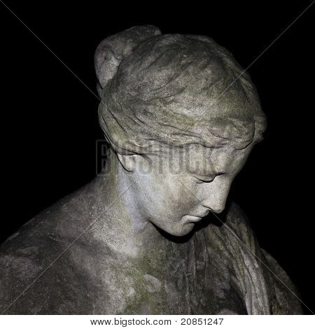 An image of a sad woman statue