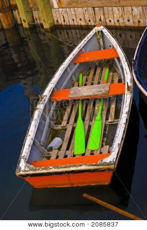 Brightly Painted Rowboat With Oars