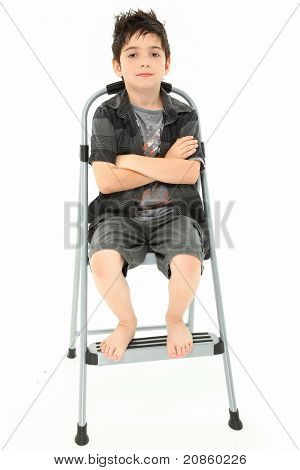 Child Sitting On Step Ladder Arms Crossed