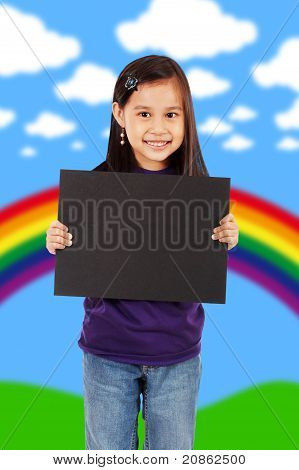 A Smiling Girl Holding A Blank Black Board