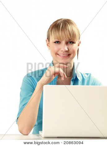 Closeup portrait of an attractive young woman with a laptop sitting at the desk, isolated on white