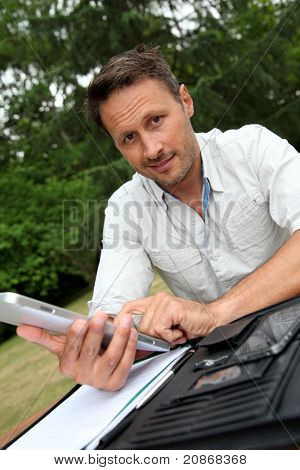 Man working with electronic tablet at home