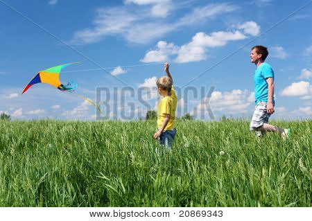 father with son in summer with kite