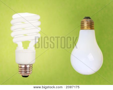 Compact Fluorescent And Regular Bulbs On Green