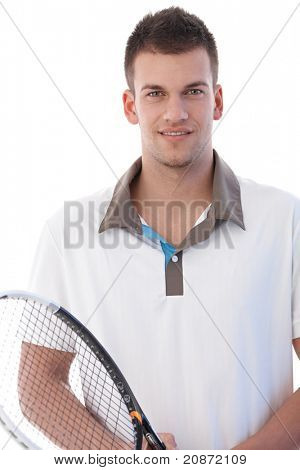 Portrait of handsome young male tennis player, smiling.?