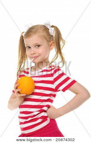 Girl drinking orange juice through straw