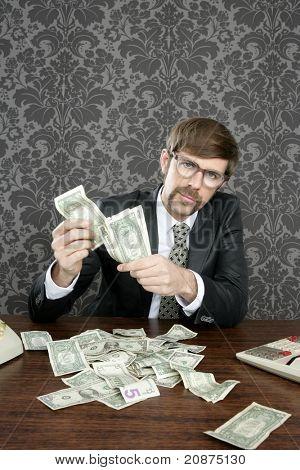 businessman nerd accountant dollar notes on vintage wallpaper office