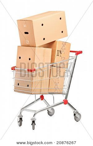 Shopping cart and stack of cardboard boxes isolated on white background