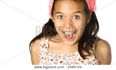 Young Girl Appearing Happy  Mouth And Eyes Wide Open
