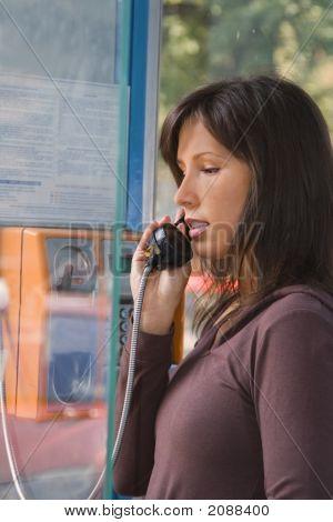 Woman In Public Phone Cabin