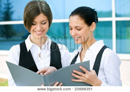 Beautiful business women on the background of office building