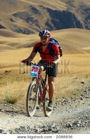 Mountain Biker On Desert Race