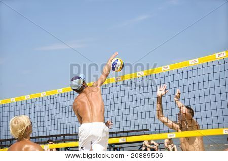 Beach Volleyball. The blow block over a grid.