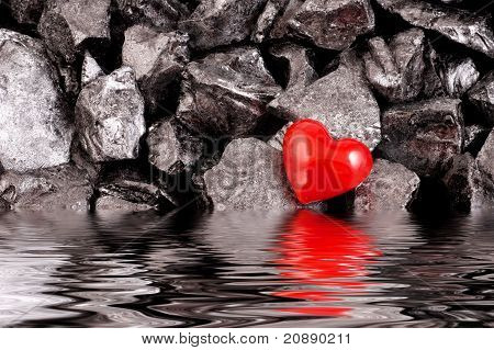 Red heart on black natural stones