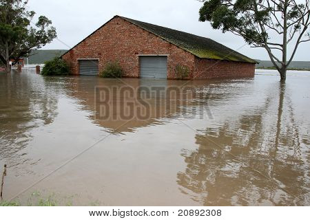 Flooded Boat House On River Bank
