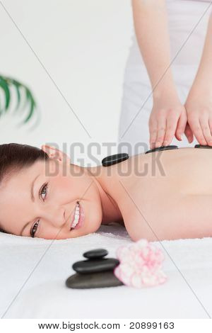 Young Redhead Woman Having A Hot Stone Massage