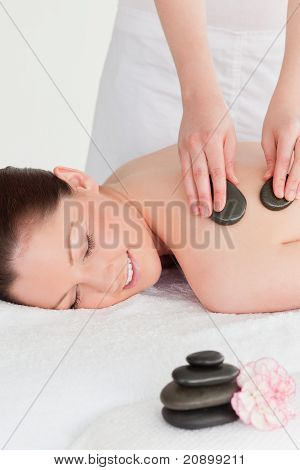 Yound Redhead Female Having A Hot Stone Massage